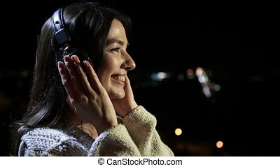Cute girl listening music with headphones outdoors - Profile...