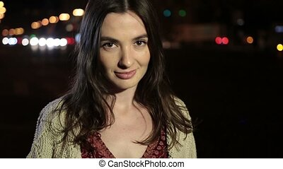 Perfect brunette woman in night city street - Portrait of...