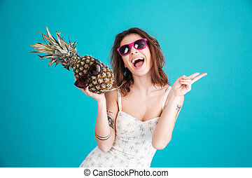 Happy young lady holding pineapple. - Image of happy young...