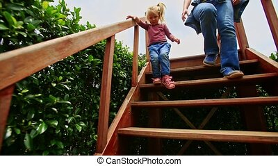 Mother Little Girl Climb down Stairs in Hedge Labyrinth in...