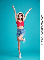 Happy young lady standing and posing isolated - Image of...