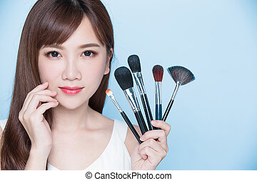 woman take makeup brush - beauty woman take makeup brush on...