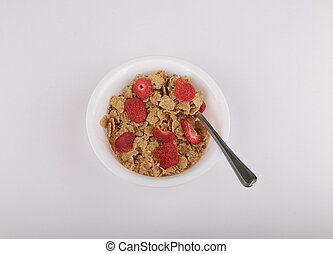 Bowl of Breakfast Cereal with Dried Strawberries - A bowl of...