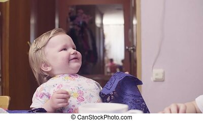 Little baby girl eating cheese and smiling 4K