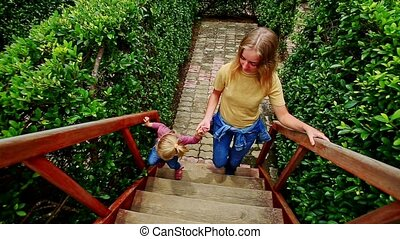 Mother Little Girl Climb up Stairs to Bridge - mother little...