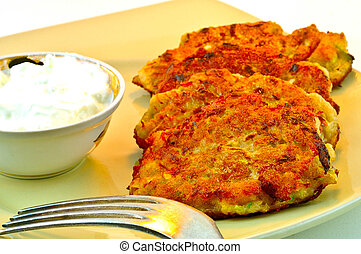 Potato Fritters - Fritters of potatoes with zucchini and...