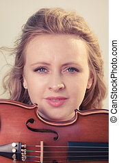 Musician violinist woman holding her violin