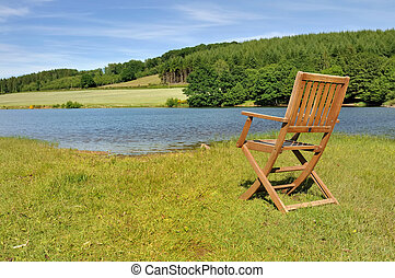 chair in front of a lake