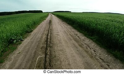 The road into the field. The road of life - The road of...