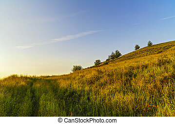 Sunset over a hill to the country in Romania