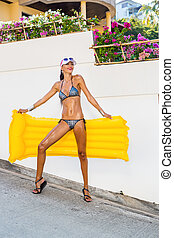 lady with long legs near white wall.