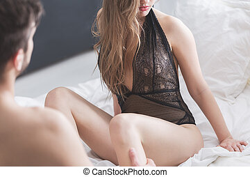 Sexy woman sitting on bed - Sexy woman in underwear sitting...