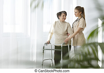 Nurse taking care of lady