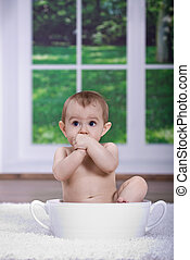 baby bath - a small bathing baby in the bathtub