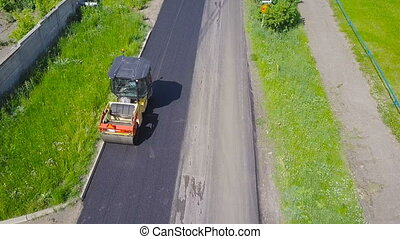 Asphalt laying. Roadwork top view