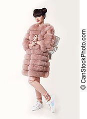 Fashion studio teen look style in pink fur coat advertise...