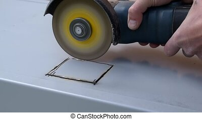 Cutting out a hole in metal with angle grinder - Cutting out...