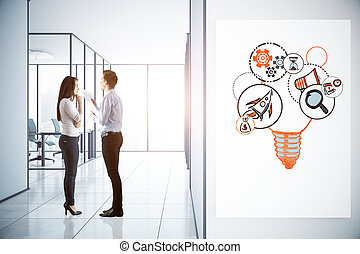 Entrepreneurship concept - Side view of young man and woman...