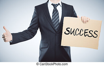Man holding success banner - Man holding carboard success...