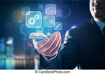 Technology concept - Close up of businessman's hand holding...