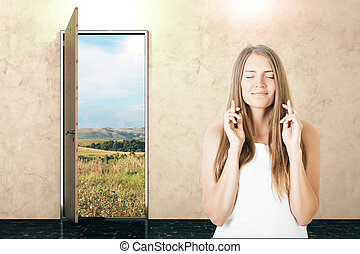 Woman crossing fingers - Open door with field view and young...