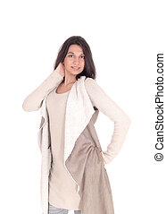 Woman standing in deerskin coat. - A young Hispanic woman...