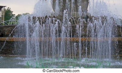 Large jets of water of a beautiful fountain. Slow motion....