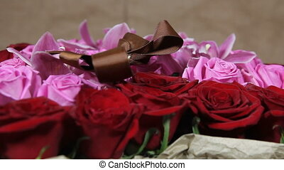 Red , pink roses and orchid flowers bouquet romantic romance love close up