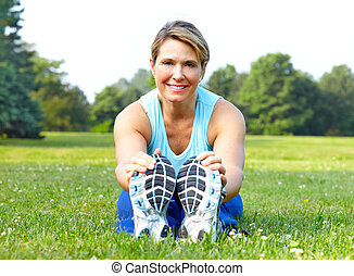Fitness - Mature woman working out in park Fitness