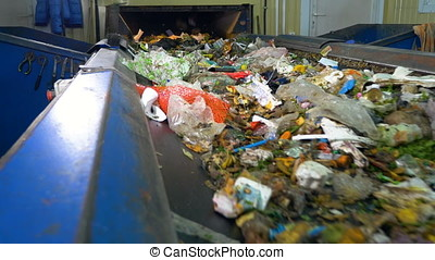 Conveyor transporting a large amount of trash. - Conveyor...