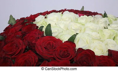 Red roses bouquet with white roses in shape of heart inside. close up