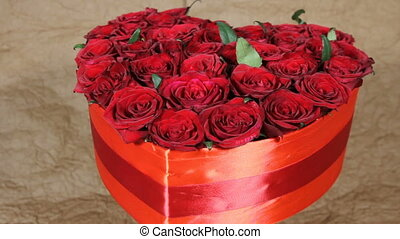 Red roses flowers bouquet in a box in the form of a heart -...
