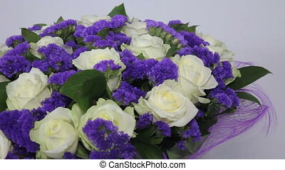 White roses flowers bouquet with violet decor. right to left...