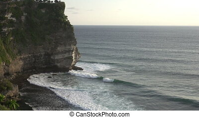 Pura Luhur Uluwatu. Bali Indonesia, the Panoramic view in time sunset