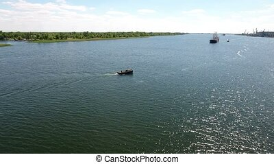 Aerial shot of ships floating along the Dnipro to Kherson port in a sunny day