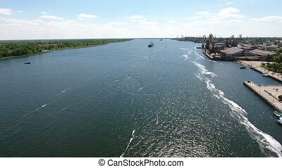 Aerial shot of Kherson city port with its high cranes and...
