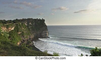 Pura Luhur Uluwatu. Bali Indonesia, the Panoramic view in time sunset