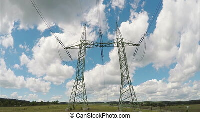 High voltage electricity tower and power lines in nature....