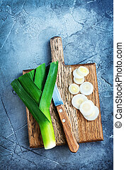 leek on wooden boards and on a table