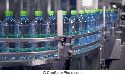 Steady moving production line of water bottles. - Water...