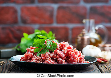 minced meat with salt and spice on a table
