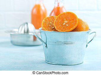 mandarins in metal bowl and on a table