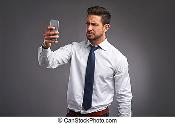 Young man with a smartphone - A handsome young man feeling...