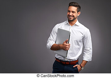 Young man with laptop - A confident handsome young man...