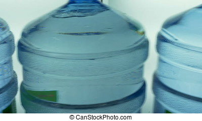 Close up of large 5 gallon water bottles. - Large and full 5...