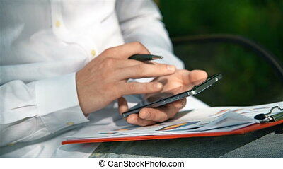 Businessman Working With Mobile Phone - Businessman Working...