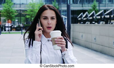 Portrait of an attractive businesswoman drinking coffee and...