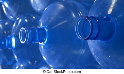 Side view of open PET bottle necks. - Large open plastic...