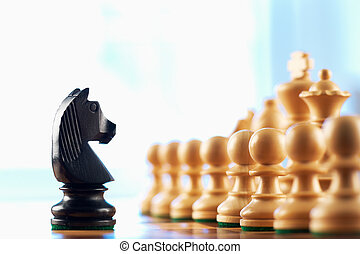 Chess black knight challenges white pawns abstract...