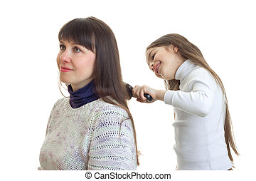 daughter combs a long hair of her mother isolated on white...